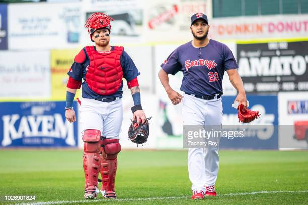 Boston Red Sox catcher Christian Vazquez and Boston Red Sox pitcher Eduardo Rodriguez walk to the dugout during a rehab assignment with the Portland...