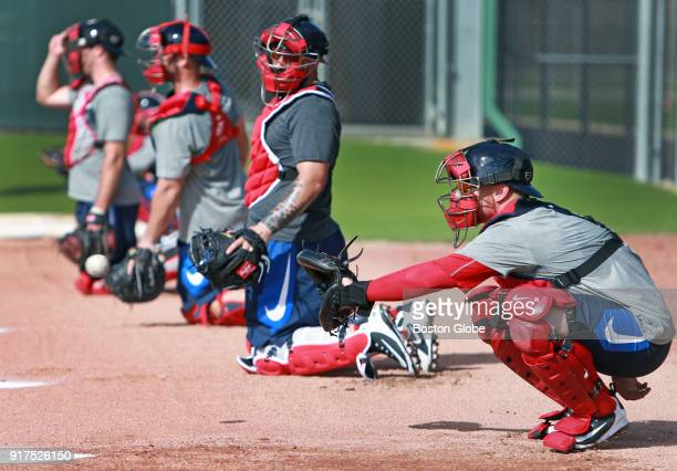 Boston Red Sox catcher Christian Vazquez foreground and other backstops work in the bullpen area during spring training at the Player Development...