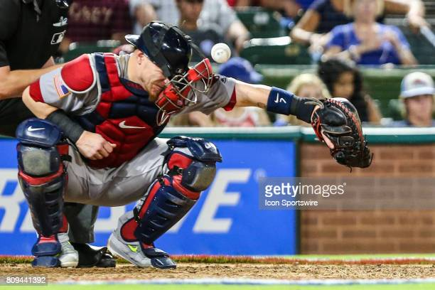 Boston Red Sox catcher Christian Vazquez gets hit by the baseball in the mask during the game between the Texas Rangers and the Boston Red Sox on...