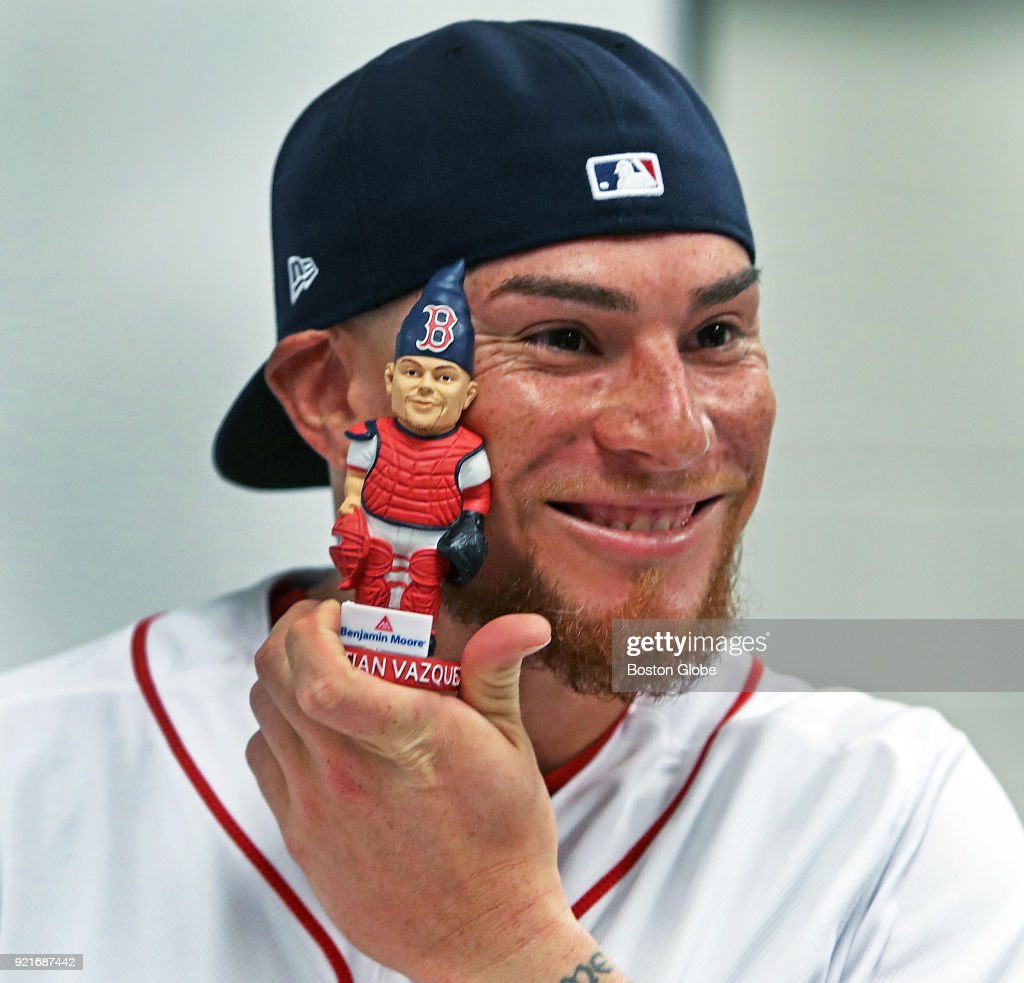 Boston Red Sox catcher Christian Vazquez holds up a doll of himself as players posed for promotional photos during spring training at the Player Development Complex at Jet Blue Park in Fort Myers, FL on Feb. 20, 2018.