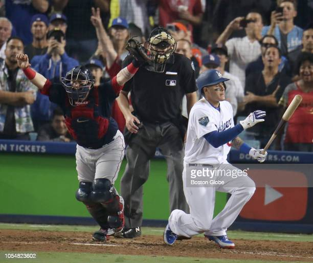 Boston Red Sox catcher Christian Vazquez left reacts after the Dodgers' Manny Machado struck out to end the game in the ninth inning The Red Sox...