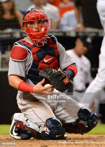 Boston Red Sox catcher Christian Vazquez look at manager Alex Cora for instructions during a game between the Miami Marlins and the Boston Red Sox on...