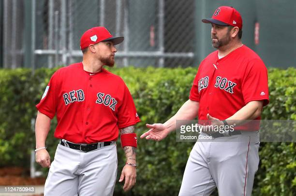 Boston Red Sox catcher Christian Vazquez talks with Red Sox instructor special assistant to Dave Dombrowski and former Sox catcher Jason Varitek...
