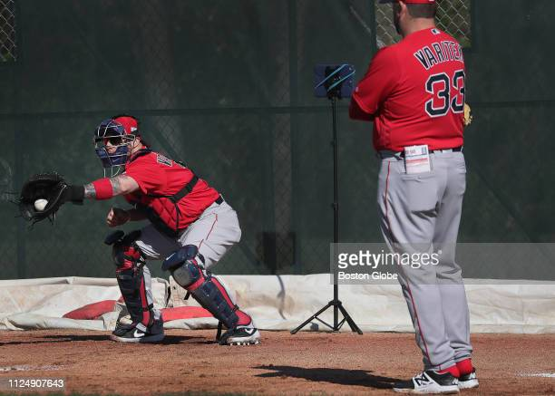 Boston Red Sox catcher Christian Vazquez works out under watchful eye of Boston Red Sox special assistant Jason Varitek during the Boston Red Sox...