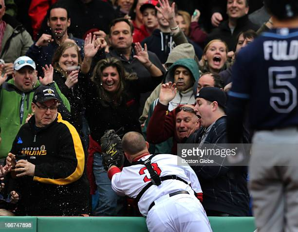 Boston Red Sox catcher David Ross fields a foul ball by Tampa Bay Rays left fielder Sam Fuld in the eighth inning as the Boston Red Sox hosted the...