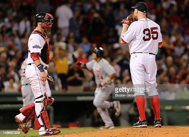 Boston Red Sox catcher Jarrod Saltalamacchia comes to the mound to talk to Sox starting pitcher Aaron Cook after Detroit Tigers third baseman Miguel...