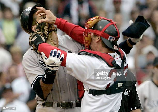 Boston Red Sox catcher Jason Varitek, right, strikes New York Yankees batter Alex Rodriguez at Fenway Park in Boston. The two fought after Rodriguez...