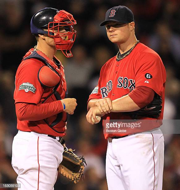 Boston Red Sox catcher Ryan Lavarnway talks with Boston Red Sox starting pitcher Jon Lester during the sixth inning as the Boston Red Sox took on the...