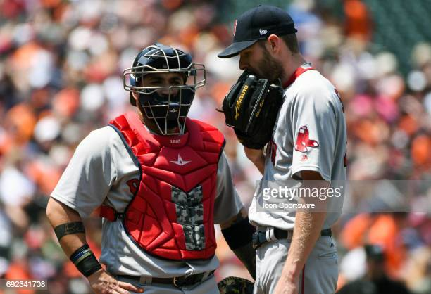 Boston Red Sox catcher Sandy Leon talks with starting pitcher Chris Sale on June 4 2017 at Orioles Park at Camden Yards in Baltimore MD The Boston...