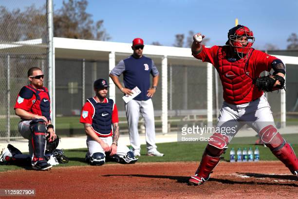 Boston Red Sox catchers Christian Vazquez Blake Swihart and Sandy Leon are pictured during a spring training catching drill workout as Red Sox...