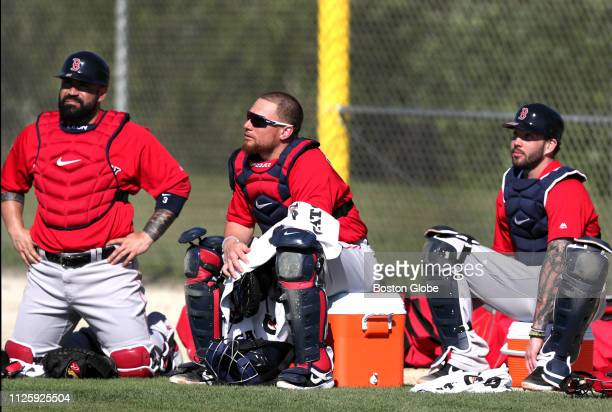 Boston Red Sox catchers Sandy Leon Christian Vazquez and Blake Swihart are pictured during a spring training workout at JetBlue Park in Fort Myers FL...