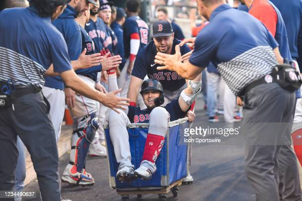 Boston Red Sox center fielder Enrique Hernandez gets a ride in the laundry cart after hitting a two run homer in the fifth inning during the Detroit...