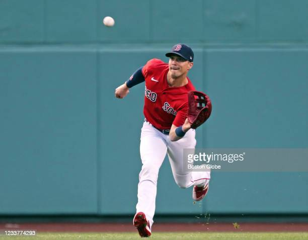 Boston Red Sox center fielder Enrique Hernandez grabs a line drive off the bat of the Royals Carlos Santana to end the top of the first inning. The...