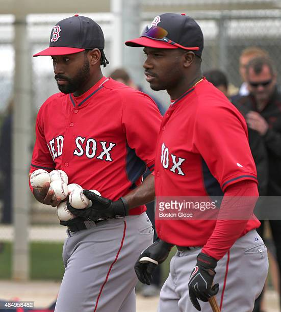 Boston Red Sox center fielder Jackie Bradley Jr and Boston Red Sox center fielder Rusney Castillo gather balls after finishing batting practice