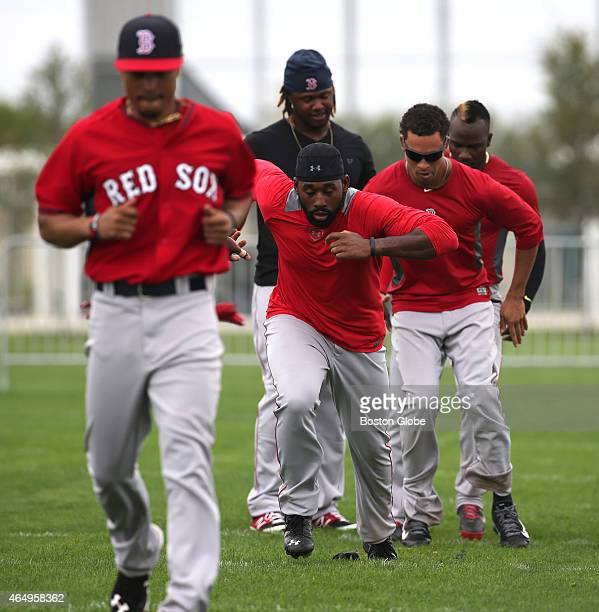 Boston Red Sox center fielder Jackie Bradley Jr. And fellow outfielders finish the day with conditioning drills.