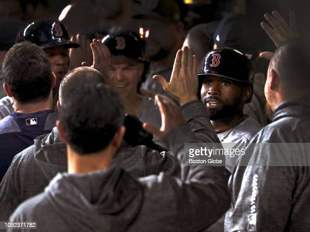 Boston Red Sox center fielder Jackie Bradley Jr and teammates celebrate in the dugout after his grand slam home run in the eighth inning The Houston...