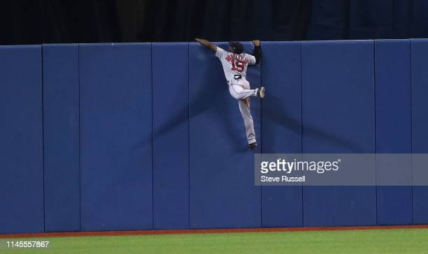 TORONTO ON MAY 22 Boston Red Sox center fielder Jackie Bradley Jr climbs the wall after unsuccessfully trying to catch a Rowdy Tellez home run as the...