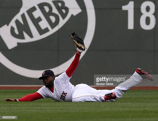 Boston Red Sox center fielder Jackie Bradley Jr dives and holds onto a drive to short center field by Toronto Blue Jays catcher Dioner Navarro not...