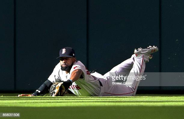 Boston Red Sox center fielder Jackie Bradley Jr dove and appeared to make the catch during the fourth inning of a fly ball hit by Houston Astros...