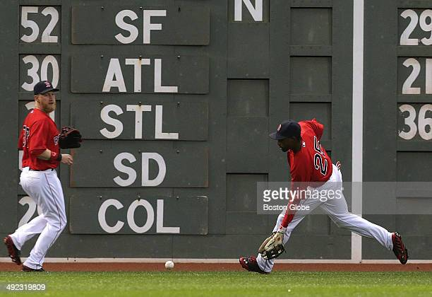 Boston Red Sox center fielder Jackie Bradley Jr fields a drive off the Green Monster by Detroit Tigers right fielder Torii Hunter not pictured that...