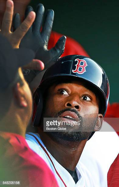 Boston Red Sox center fielder Jackie Bradley, Jr. Gets a hand in the dugout following his solo home run in the bottom of the second inning of a game...