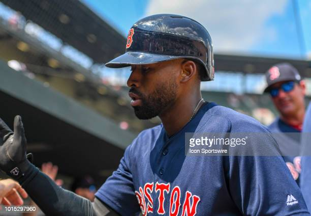 Boston Red Sox center fielder Jackie Bradley Jr is congratulated in the dugout after hitting a fifth inning solo home run during the game between the...