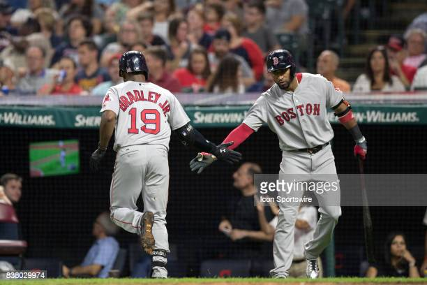 Boston Red Sox center fielder Jackie Bradley Jr is greeted by Boston Red Sox infielder Eduardo Nunez after hitting a home run during the fourth...