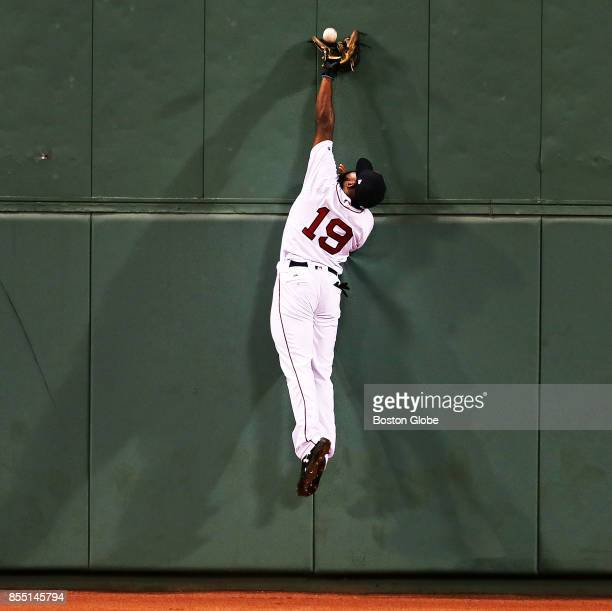 Boston Red Sox center fielder Jackie Bradley Jr leaps but just misses a top of the ninth inning double off the wall hit by Toronto's Ryan Goins The...