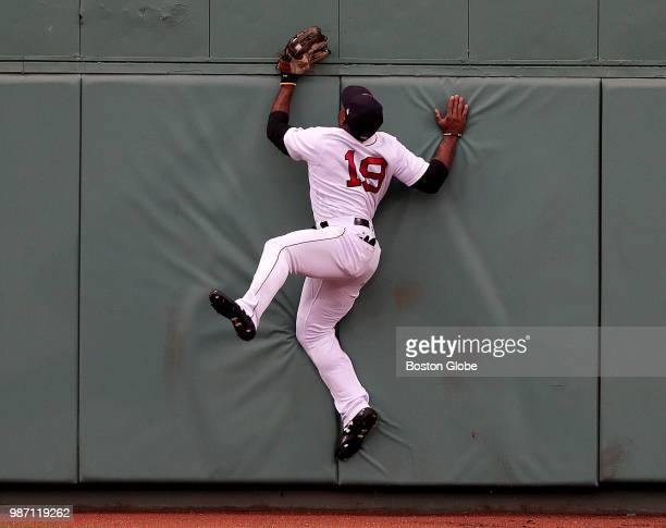 Boston Red Sox center fielder Jackie Bradley Jr leaps to make the catch on a deep drive to center field by Los Angeles Angels left fielder Justin...
