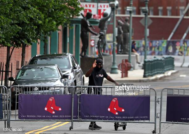 Boston Red Sox center fielder Jackie Bradley Jr. Leaves Fenway Park in Boston on a scooter after COVID-19 testing required for all players for the...