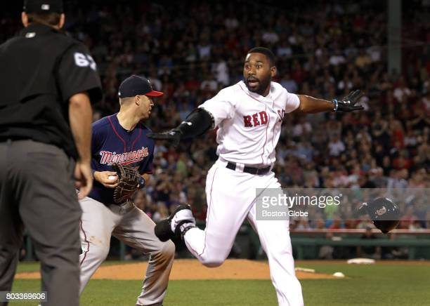 Boston Red Sox center fielder Jackie Bradley Jr looks for the safe call but after a video review Bradley was ruled out on a close play at first...