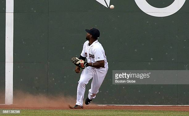 Boston Red Sox center fielder Jackie Bradley Jr looks over his head for the ball that hit the wall during the second inning of a game agains the New...