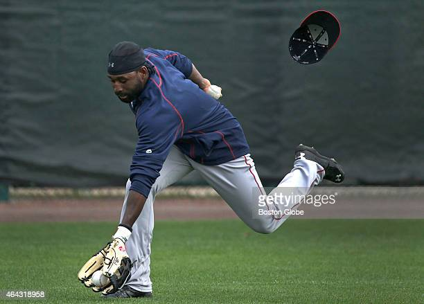 Boston Red Sox center fielder Jackie Bradley Jr loses his hat as he fields fly balls during today's informal workout