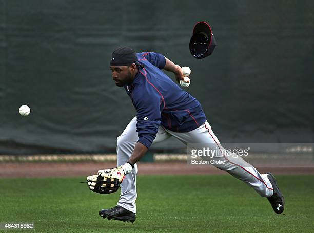 Boston Red Sox center fielder Jackie Bradley Jr. Loses his hat as he fields fly balls during today's informal workout.