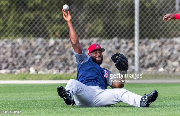 Boston Red Sox center fielder Jackie Bradley Jr makes a diving catch during sun drills where outfielders turn their backs to the infield and scramble...