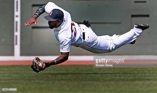 Boston Red Sox center fielder Jackie Bradley Jr makes a diving catch to take a hit away from Toronto Blue Jays shortstop Troy Tulowitzki in the top...