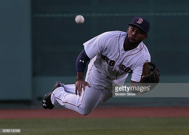 Boston Red Sox center fielder Jackie Bradley Jr makes a diving catch of a line drive to center field by Atlanta Braves shortstop Daniel Castro not...