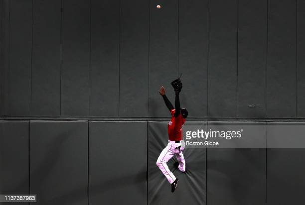 Boston Red Sox center fielder Jackie Bradley Jr makes a leaping catch against the Green Monster to rob Baltimore Orioles right fielder Joey Rickard...
