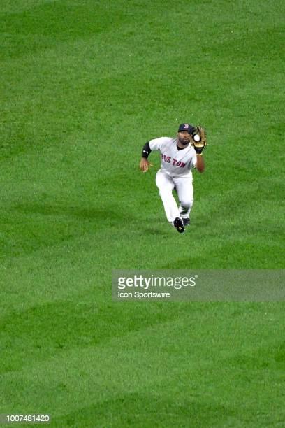 Boston Red Sox center fielder Jackie Bradley Jr makes a running catch in the seventh inning during the game between the Boston Red Sox and the...