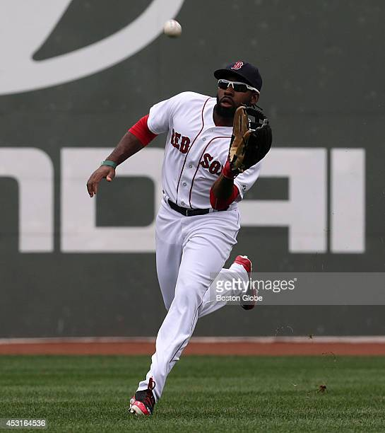 Boston Red Sox center fielder Jackie Bradley Jr makes a running catch and throw to double up baserunner Derek Jeter not pictured at first base The...