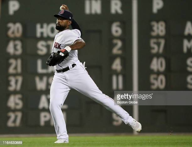 Boston Red Sox center fielder Jackie Bradley Jr makes a throwing error after making a running catch during the seventh inning The Boston Red Sox host...