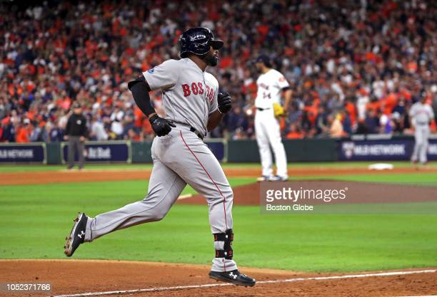 Boston Red Sox center fielder Jackie Bradley Jr rounds third base heading for home after his grand slam home run off of Houston Astros relief pitcher...