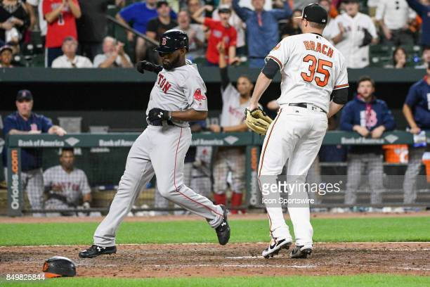 Boston Red Sox center fielder Jackie Bradley Jr scores on an eleventh inning wild pitch from Baltimore Orioles relief pitcher Brad Brach during an...