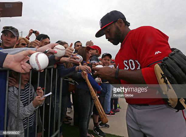 Boston Red Sox center fielder Jackie Bradley Jr signs autographs for fans after the day's workout