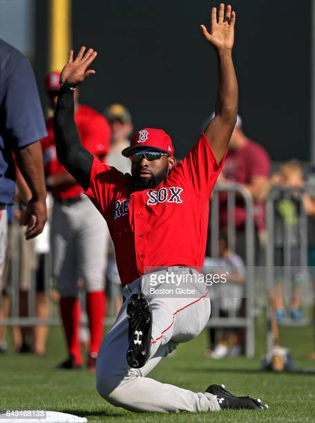 Boston Red Sox center fielder Jackie Bradley Jr slides into the bag during a sliding drill on day eight of Red Sox Spring Training at Jet Blue Park...