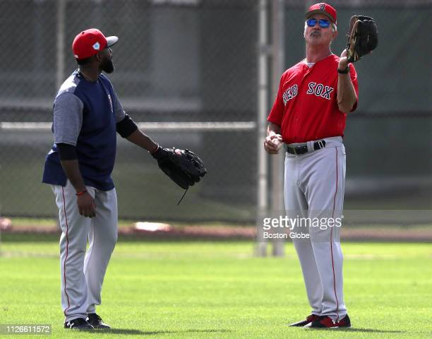 Boston Red Sox center fielder Jackie Bradley Jr stands with former Red Sox right fielder Dwight Dewey Evans during spring training at JetBlue Park in...