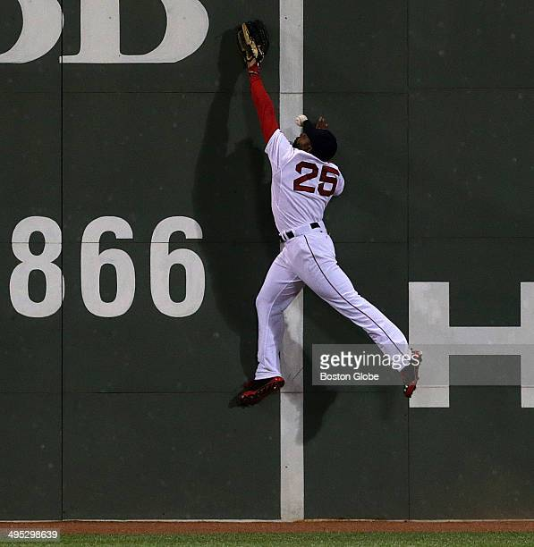 Boston Red Sox center fielder Jackie Bradley Jr was injured on this play attempting to catch a high drive off the Green Monster by Tampa Bay Rays...