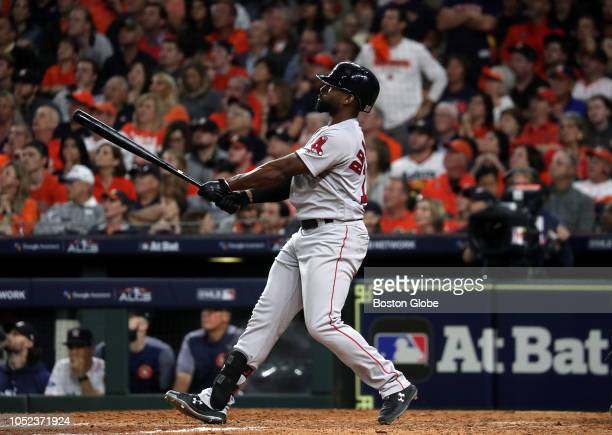 Boston Red Sox center fielder Jackie Bradley Jr watches his grand slam home run leave the park in the eighth inning The Houston Astros host the...