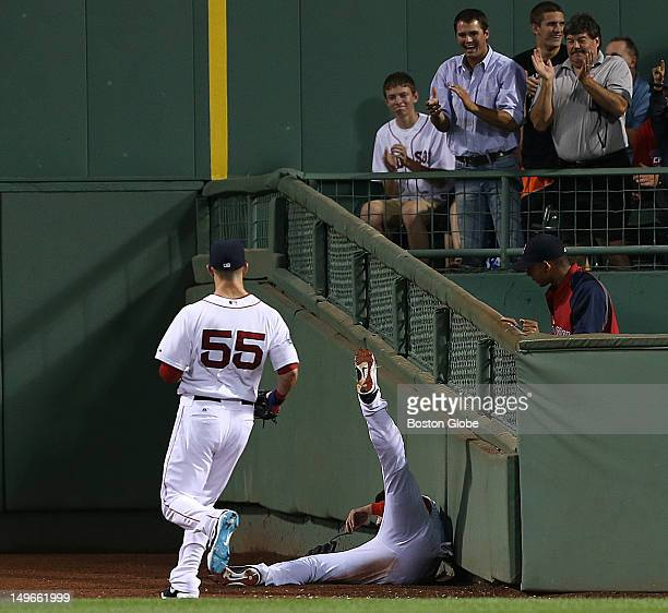 Boston Red Sox center fielder Jacoby Ellsbury makes a spectacular defensive catch of a long drive to center by Detroit Tigers designated hitter...