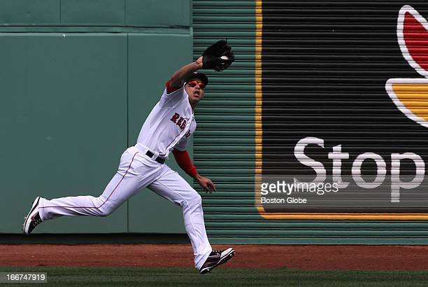 Boston Red Sox center fielder Jacoby Ellsbury tracks down and makes the catch of a long fly ball to deep center field by Tampa Bay Rays right fielder...